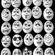 White eggs and many funny faces — Stock Photo #11225701