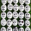 White eggs and many funny faces — Stock Photo #11225803