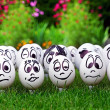 White eggs and many funny faces, garden party — Stock Photo #11679261