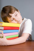 Tired boy sleeps on the books — Stock Photo