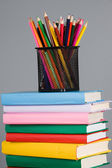 Colored pencils and a stack of books — Stock Photo
