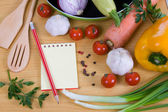 Fresh vegetables and a notebook — Stock Photo