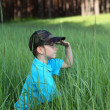 Boy sitting in tall grass — Stock Photo