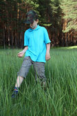 Boy in the tall grass — Stock Photo