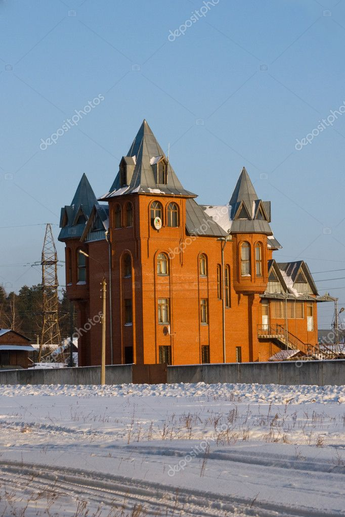 Brick cottage against a blue sky in the winter — Stock Photo #11995930
