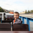 Boy riding excursion boat — Stock Photo