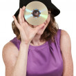 Woman holding CD or DVD — Stock Photo
