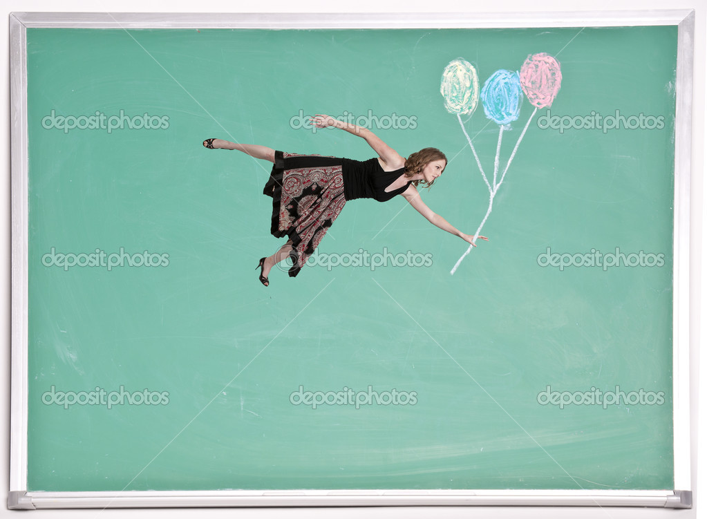 A beautiful young woman floating with balloons on a chalkboard — Stock Photo #10918395