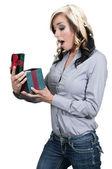 Beautiful woman opening a present — Stock Photo