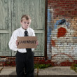 图库照片: Little Boy Holding Unemployment Sign