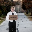 Foto de Stock  : Little Boy Holding Unemployment Sign
