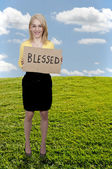 Woman Holding Sign that says Blessed — Stock Photo