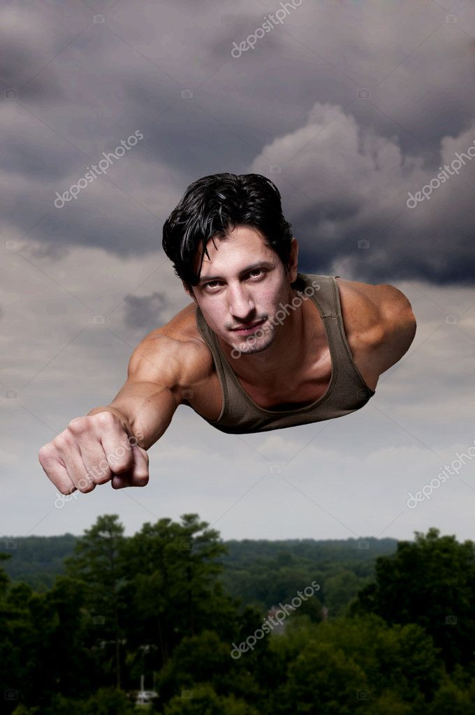 Handsome man super hero flying through the sky — Stock Photo #12250586