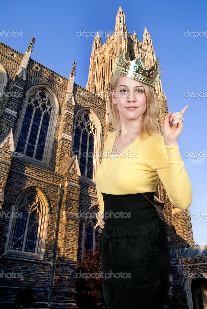 Beautiful young queen woman wearing a crown — Stock Photo #12251561