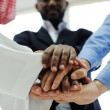 Business team overlapping hands — Stock Photo #11675531