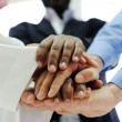 Foto Stock: Business team overlapping hands