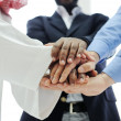 Business team overlapping hands — Stock Photo #11675547