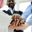 Business team overlapping hands — Stock Photo #11675558