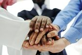Business team overlapping hands — Stok fotoğraf