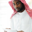 Arabic executive person using tablet at office — Stock Photo #11689142