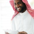 Arabic executive person using tablet at office — Stock Photo