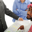 Architects at Middle east discussing engineering design project — Stock Photo