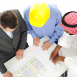 Stock Photo: Architects at Middle east discussing engineering design project