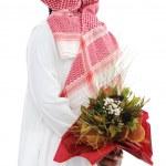 Mellanöstern man gömmer sig bakom en rosor för sin fru — Stockfoto