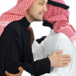 Stock Photo: Two Arabic men having warm meeting