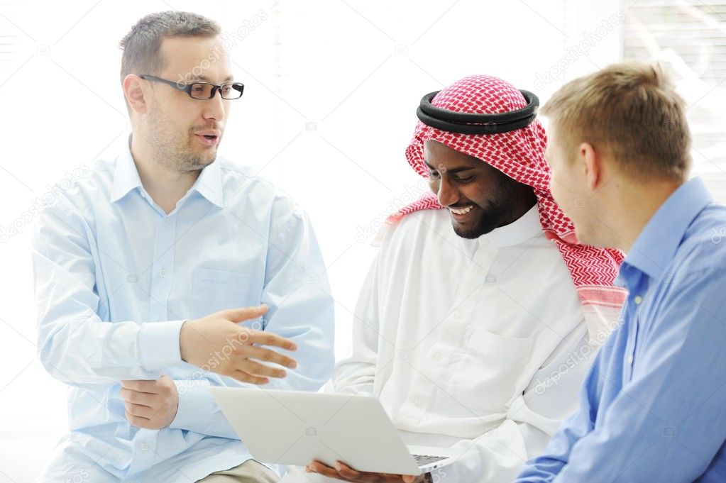 Multicultural different ethnic group working on laptop together — Stock Photo #11689198