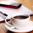 Cup of coffee on the desk — Stock Photo
