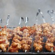 Fresh meat prepared on fire - Stock Photo