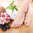 Stock Photo: Beautiful legs and different spa items
