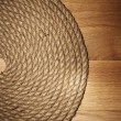Old rope over wooden surface - Stock Photo