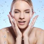 Beautiful woman washing her face — Stock Photo