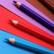Pencils on colorful paper — Stock Photo