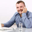 Foto Stock: Happy businessman talking by cellphone