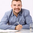Handsome businessman at his workplace — Stock Photo