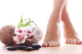 Beautiful legs and different spa items — Stock Photo