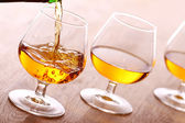 Pouring cognac into the glass — Stock Photo