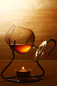Glass of hot cognac — Stock Photo