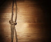 Old rope over wooden surface — Stock Photo