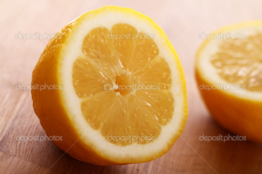 Close up of fresh lemons on wooden board  Stock Photo #10926866