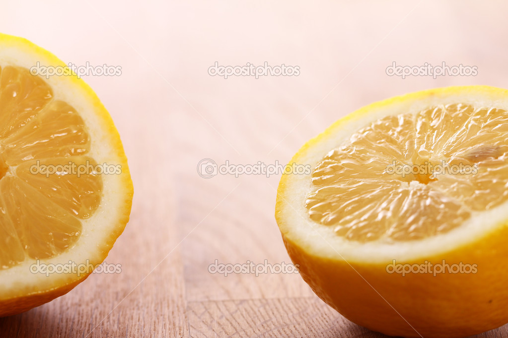 Close up of fresh lemons on wooden board — Stock Photo #10926870