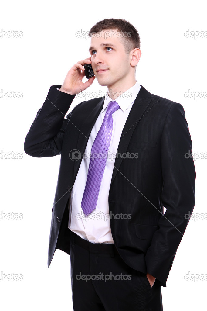 Young and handsome businessman using cellphone over white background — Stock Photo #10928809