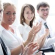 Businesspeople applauding during a meeting - Foto Stock
