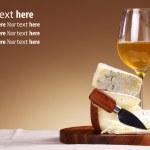 Wine and fresh cheese — Stock Photo