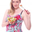 Happy woman with bowl of fresh salad - Stock Photo