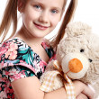 Cute girl with her teddy bear — Stock Photo #10931225