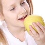 Cute girl with fresh apple — Stock Photo